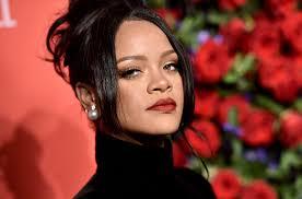 Rihanna poses topless to Popcaan song