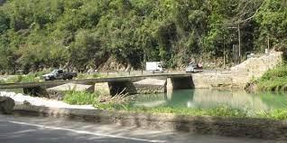 One woman dies after minibus plunges into Rio Cobre